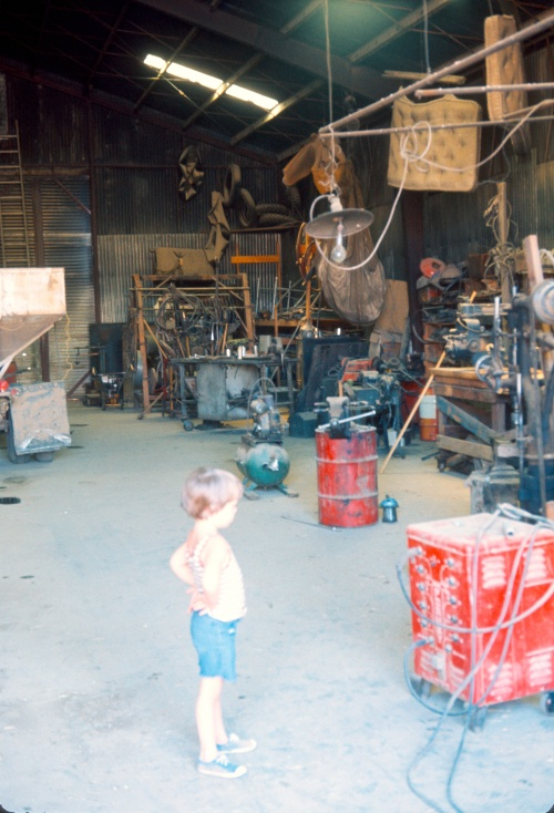 1973 Jul On the farm in the Shop Scott and the equipment