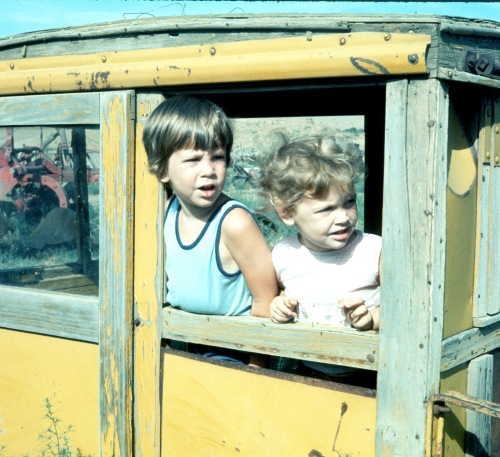 1973 Jul Scott and Sherry in Old Cat Cab on farm