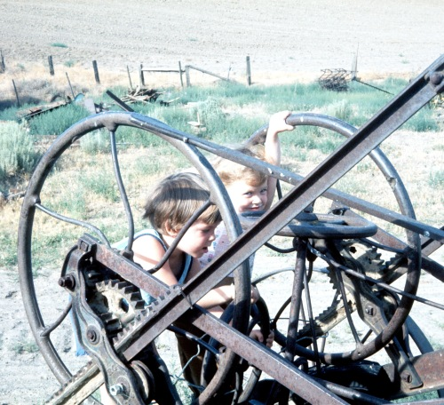 1973 Jul Scott and Sherry on Farm Equipment in Pendleton Oregon