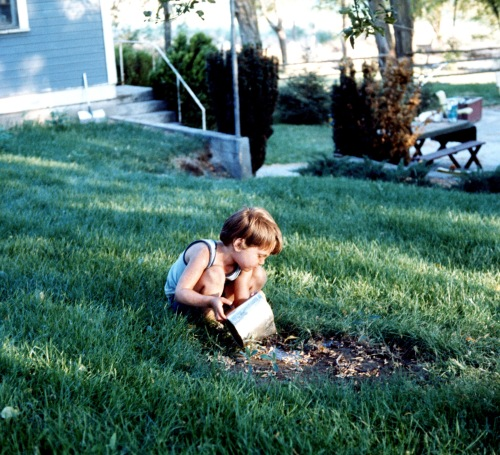 1973 Sep Scott watering a plant